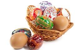Easter eggs in basket. Adorned the Ukrainian folk patterns Easter eggs in basket isolated on white background Stock Photo