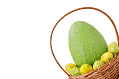 Easter eggs in a basket. On white background Royalty Free Stock Image