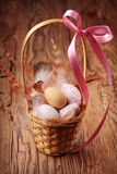 Easter eggs in basket Stock Photos