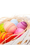Easter eggs in the basket. Rainbow Easter eggs. Close-up image of hand painted colorful Easter eggs arranged with natural hay in the basket Royalty Free Stock Photography