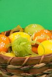 Easter eggs in a basket. On an green background Stock Photo
