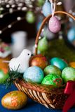 Easter eggs basket. On table Royalty Free Stock Photos