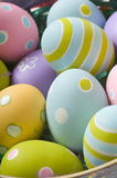 Easter Eggs in Basket. Brightly colored Easter eggs in a basket Stock Image