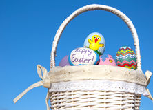 Easter eggs in basket against blue sky Royalty Free Stock Images