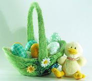 Easter eggs basket and baby chicken. Easter eggs basket and a baby chicken toy Royalty Free Stock Images