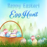 Easter eggs in the basket Background with field of trees and colored eggs in the grass Stock Photos