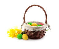 Easter eggs in the basket with bouquet of daffodil Royalty Free Stock Image