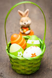 Easter eggs. In a basket with easter bunny in background Stock Photos