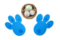 Easter eggs in a basket and bunny tracks Royalty Free Stock Images