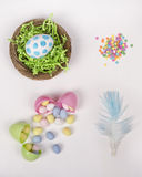 Easter eggs, basket, and candy on a white background Royalty Free Stock Images