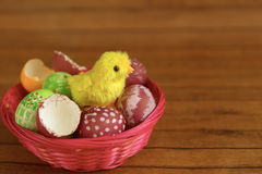 Easter eggs in basket, chick hatching from shell Royalty Free Stock Photography