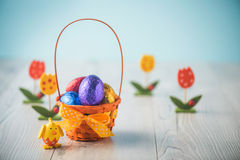 Easter eggs in a basket. Color full easter eggs in a basket on a white table Stock Photos