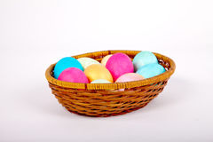 Easter eggs in a basket. Easter colored eggs in the basket on white Royalty Free Stock Image