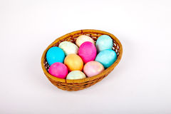 Easter eggs in a basket. Easter colored eggs in the basket on white Stock Image