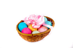 Easter eggs in a basket. Easter colored eggs in the basket on white Stock Images