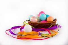 Easter eggs in a basket. Easter colored eggs in the basket on white Stock Photo