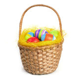 Easter eggs in a basket. Coloured easter eggs in a braided basket Stock Photos