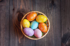 Easter eggs in a basket. Easter eggs on a dark background stock photos