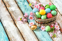 Easter eggs basket decoration flowers wooden background Stock Images