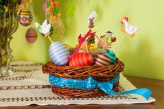 Easter eggs and basket decoration on the tabletop Stock Images