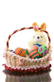 Easter eggs in basket with fat round bunny Stock Photos