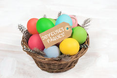 Easter eggs in basket with feather decoration Royalty Free Stock Image