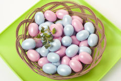 Easter eggs. In a basket on a green background Stock Photos
