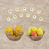 Easter eggs in a basket . Easter eggs in a basket with a happy wishes Stock Photography