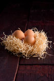 Easter eggs in the basket of hay Stock Images