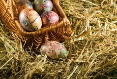 Easter eggs in basket in the hay. Image of easter eggs in basket in the hay Royalty Free Stock Photo