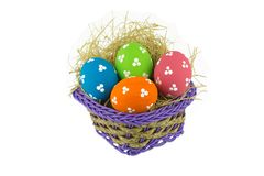 Easter eggs and basket isolated stock photo