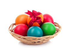 Easter eggs in basket isolated Royalty Free Stock Photography