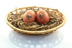 Easter eggs in the basket of isolated on a white background Stock Photo
