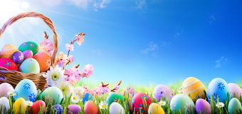Easter Eggs In Basket. And On Meadow Royalty Free Stock Photography