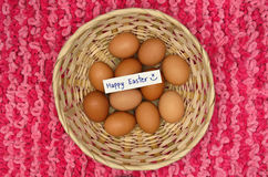 Easter eggs in basket with note Stock Photos