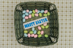 Easter eggs in basket with note Royalty Free Stock Photo
