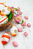 Easter eggs in a basket. On a old wooden background Stock Photos