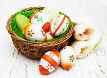 Easter eggs in a basket. On a old wooden background Stock Images