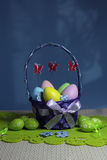 Easter eggs basket. Painted eggs. Easter background. Easter theme decoration. Colorful easter eggs on blue background Stock Photo