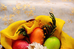 Easter eggs in basket, painted in different colors with pearly shimmer Royalty Free Stock Images