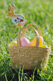 Easter eggs in a basket with rabbit decorations Stock Images