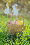Easter eggs in a basket with rabbit decorations Royalty Free Stock Photo