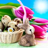 Easter eggs in the basket and rabbit stock images