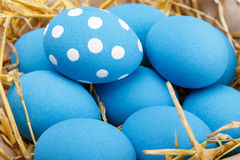 Easter eggs in a basket on rustic wooden background, selective focus image, Happy Easter. Blue Easter eggs Royalty Free Stock Image