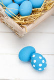 Easter eggs in a basket on rustic wooden background, selective focus image, Happy Easter. Blue Easter eggs Stock Photo