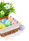 Easter eggs in basket with spring flowers Stock Photo