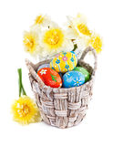 Easter eggs in basket with spring flowers Stock Image