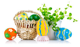 Easter eggs in basket with spring leaves Stock Image