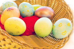 Easter eggs in a basket with a stone in the Royalty Free Stock Image