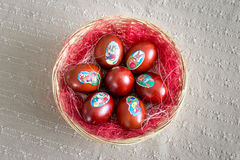Easter eggs in the basket on the table nicely sorted Stock Image